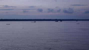 River landscape with fishing boats and dredging boats at dusk video