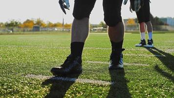Football players stretching before a game