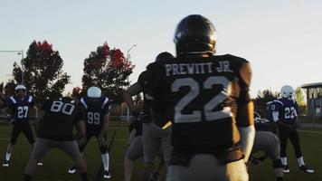 Football players running a play on the field video