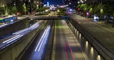 Night scene of urban traffic.Time Lapse - Trail effect - Long exposure - 4K. (02)