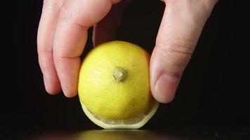 Human hand takes away a half of lemon