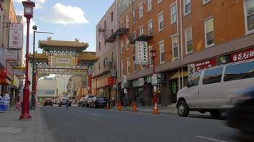 Usa day time philadelphia city china town street traffic panorama 4k