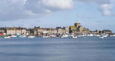 The port of Barfleur, France during the daytime