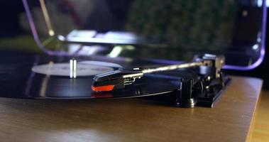 Turntable, surface level close up, stylus on turning record, shot on R3D