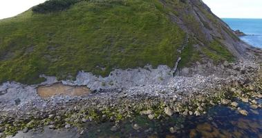 Aerial view past steep cliffs