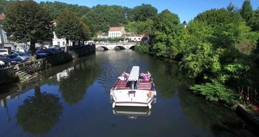 Touristic boat floats on the river in Brantome