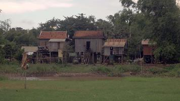 Typical asian village with wooden stilt houses