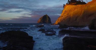 Aerial View Revealing Rocky Sea Cliffs Coastline with Amazing Sunrise Light in Pacific Northwest
