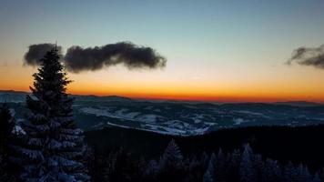 Sundown time lapse in winter mountain