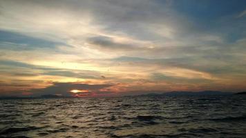 Traveling through the sea splashing water sunset