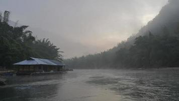Time lapse of foggy misty morning at raft house video