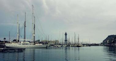 Yachts port, Barcelona, Spain. Sailboats in yacht marina under clouds sky video
