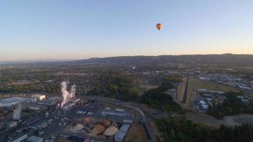 Hot air balloons float over small town video
