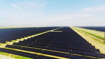Solar Farm Overhead aerial view of vast alternative energy sun power farm with thousands of solar panels over miles of California valley farmland video