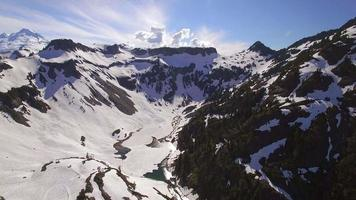 Beautiful Aerial of Mountain Ridges Melting Snow into Valley River