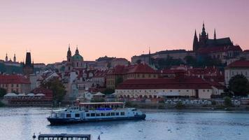Evening in Prague on Vltava River. Time Lapse UHD