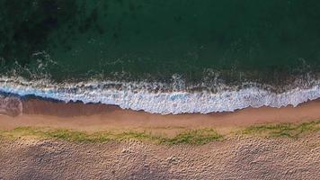 Aerial view of beach ocean waves and boat