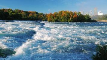 Turbulent Niagara River before the waterfall. On a clear autumn day