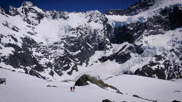 Climbers in the snow at Mueller Hut near Mount Cook, New Zealand.
