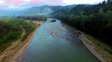 Aerial view of the mountain river in Carpathians on sunrise
