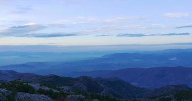 sunset panorama mountain range view from hill 4k spain video