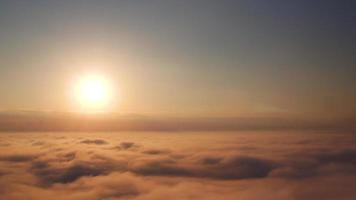 Flying above the clouds. Sunrise. Aerial view.