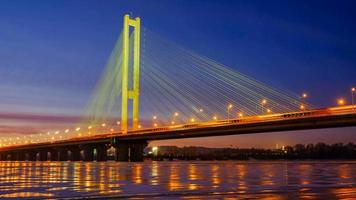 Timelapse of illuminated bridge and night Kiev city