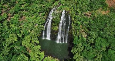Aerial view of amazing double waterfall in tropical rain forest jungle