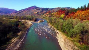 Aerial view of the mountain river in Carpathians. Autumn.