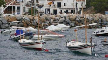 Anchored Boats in Front of a Mediterranean Village video