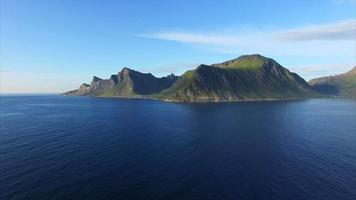 Flying over ocean by scenic Lofoten coastline
