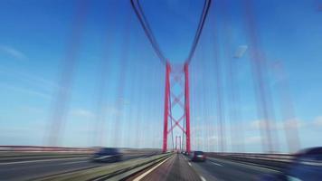 Speedy Driving on a 25 de Abril Bridge in Lisbon