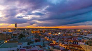 seville beautiful sunset city panorama from the roof top 4k time lapse spain