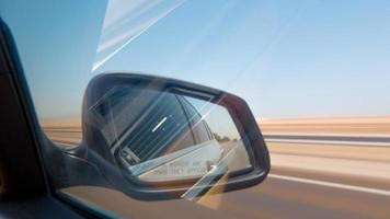 Uae summer day united arab emirates road trip side mirror view 4k time lapse