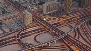sunset night illumination traffic road junction roof top view 4k time lapse united arab emirates