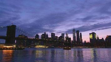 View of Brooklyn Bridge with the distinctive New York skyline at sunset
