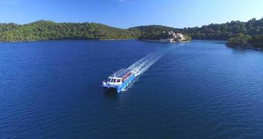 Aerial view of catamaran sailing off St. Mary island on island of Mljet, Croatia video