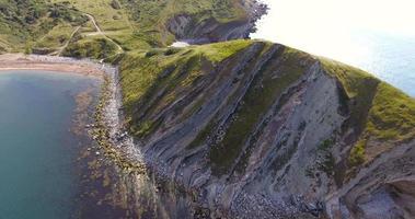 Aerial view past steep cliffs