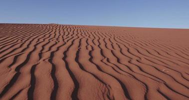 4K close-up moving shot of ripples in the surface of a sand dune inside the Namib-Naukluft National Park