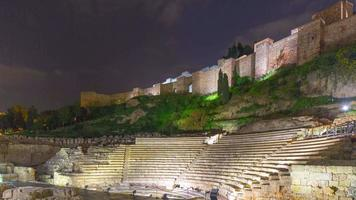 notte luce città di malaga castello Colosseo rovina lasso di tempo 4K spagna