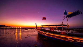 4K TimeLapse. Dawn in the sea against the backdrop of a fishing boat in Phuket, Thailand. January, 2016. video