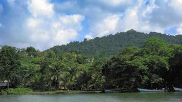 Scenic view of beach with trees and mountain against cloudy sky, Trinidad, Trinidad and Tobago