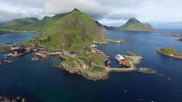 Red fishing huts in Mortsund on Lofoten islands in Norway, aerial view