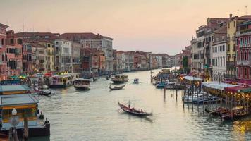 italy sunset light most famous rialto bridge grand canal traffic panorama 4k time lapse venice video