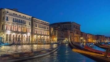 italy night illumination venice city famous grand canal gandola parking panorama 4k time lapse video