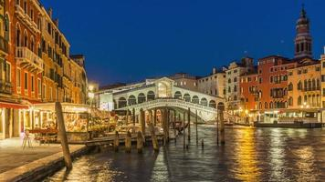 italy night illumination famous rialto bridge grand canal restaurant panorama 4k time lapse venice video