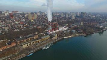 Modern aerial cityscape with a thermal power plant and river. video