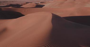 4K panning shot of the endless sand dunes of the Namib desert inside the Namib-Naukluft National Park