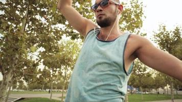 Guy walks on slackline at public park video