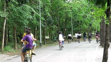 Group of People Bicycling in public park of Bangkok